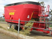NDE vertical feed mixer cuts waste