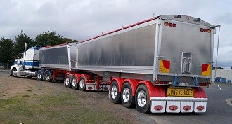 Dunstan answers to bulk grain handling needs with B-Double tipper