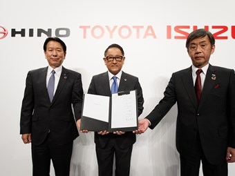 Japanese auto trio in truck technology link