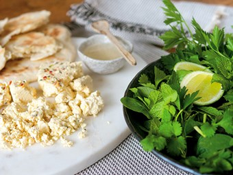 Herb salad with flatbreads and feta