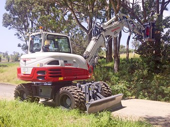 Takeuchi TB295W wheeled excavator equipment focus