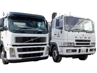 Volvo FM12 vs. Fuso FV54J tripper truck reviews