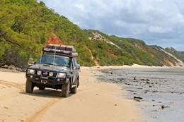 4x4 driving on Elim Beach in Queensland