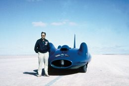 Donald Campbell standing with Bluebird