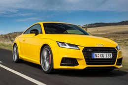 Audi TTS driving on road