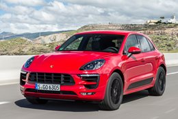 Red Porsche Macan Driving