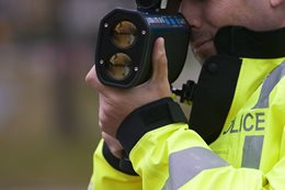 Police officer with speed trap gun