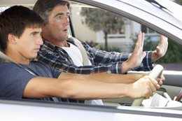 Father teaching his son to drive