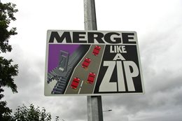 Sign showing motorists how to merge
