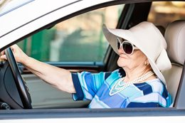 Elderly lady driving car