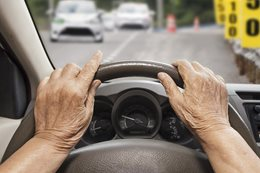 elderly driver hands on steering wheel