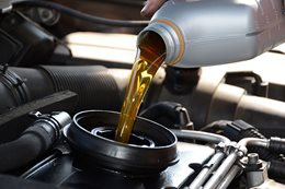 Engine oil being poured into car
