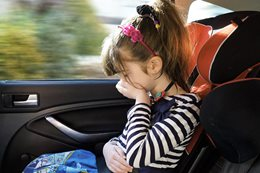 girl sick in car
