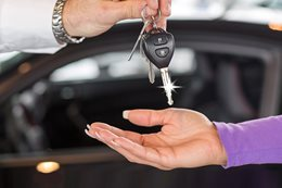 Women getting keys to new car