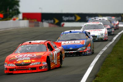 Ambrose beats up on Kyle Busch  to win Nationwide race at the Glen