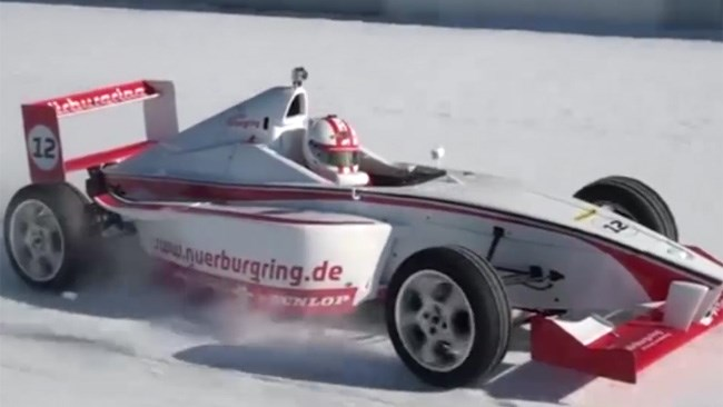 Formula racer laps snow-covered Nurburgring