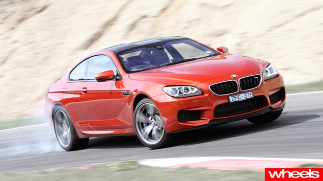 Rear tyres struggle to contain the M6's brutal 412kW engine