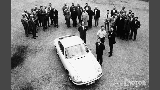 The 911 team with Ferry Porsche in foreground