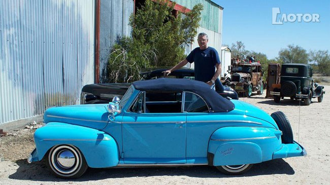 Ernie Adams and his mini 1942 Ford Convertible