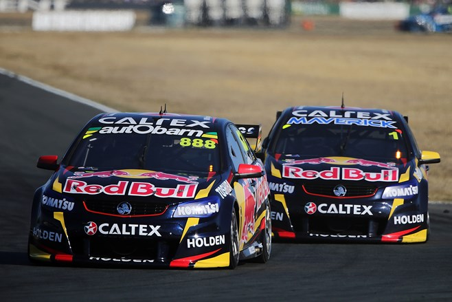 Jamie Whincup in pursuit at Queensland Raceway