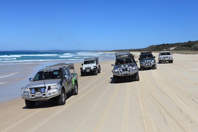 4x4 vehicles driving on a beach