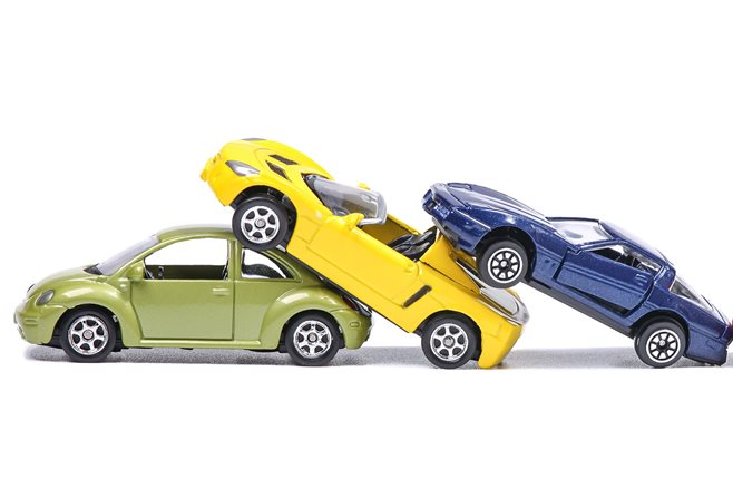 toy cars simulating a car crash