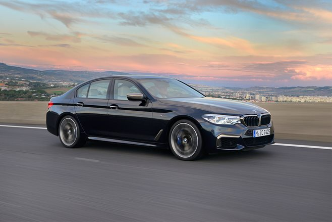 BMW M550i 2017 side front driving