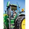 Amy and Ritchie Cudby try the massive John Deere 7R for size