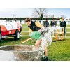 Joseph Watts empties a water trough during the agri sports challenge FMG Young Farmer of the Year