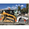 Cat skid steer loader with EasyGrade attachment