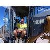 Russell 'The Gun' Lambert with Bulmer's Cat 140M grader.