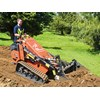Josh Simpson operates the Ditch Witch SK755 mini skid steer loader.