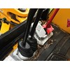 Detail showing the JCB 3CX backhoe loader stick attached to the JCB 8025 ZTS slew foot control.