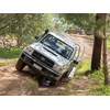 Toyota Landcruiser 70 series in offroad ditch