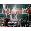Auriol sprays the champagne at the 1990 Monte Carlo Rally