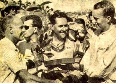 John Youl, centre, receiving one of many trophies