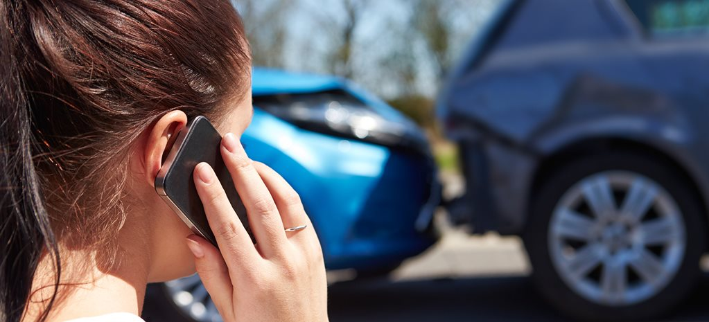 Lady on phone after car accident
