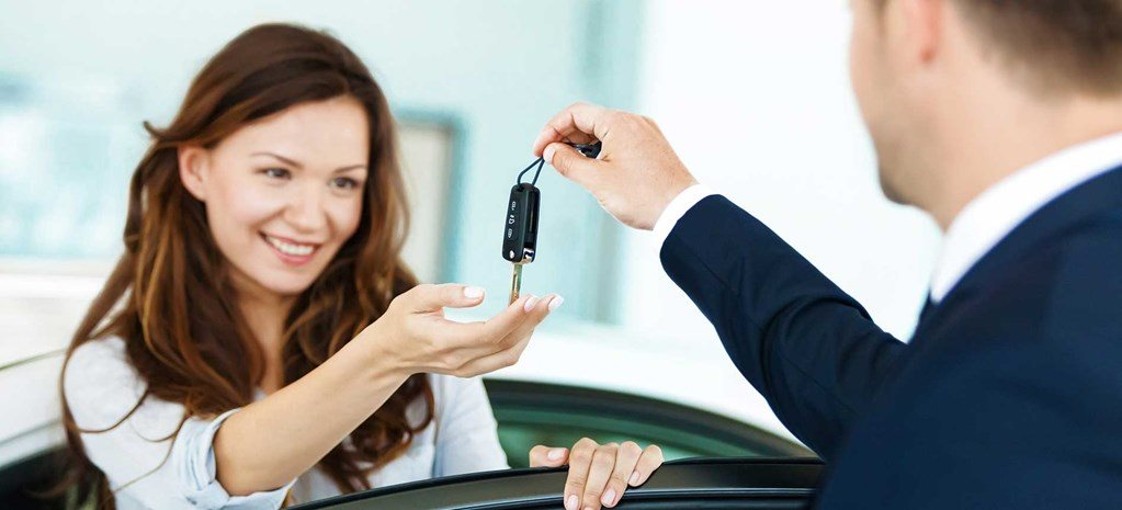 woman getting keys to new car