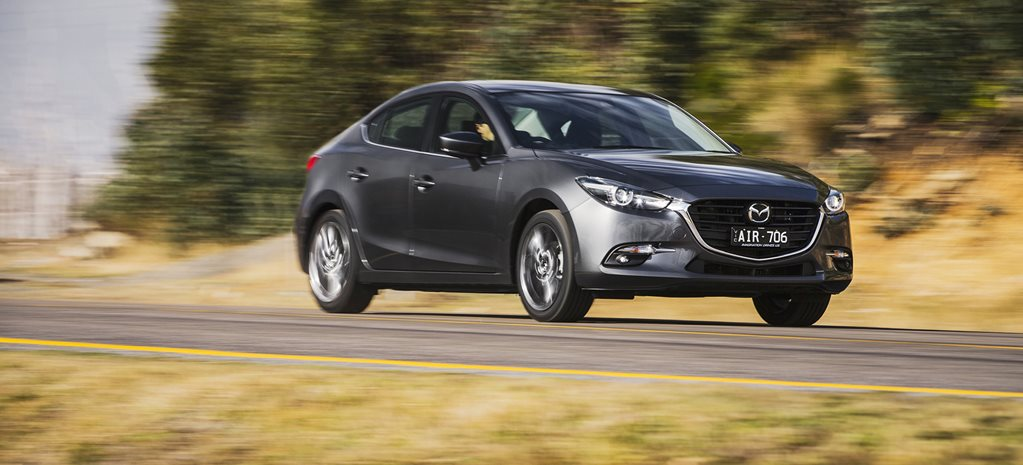 Mazda 3 vs Subaru Impreza: Which small car is best for country driving?