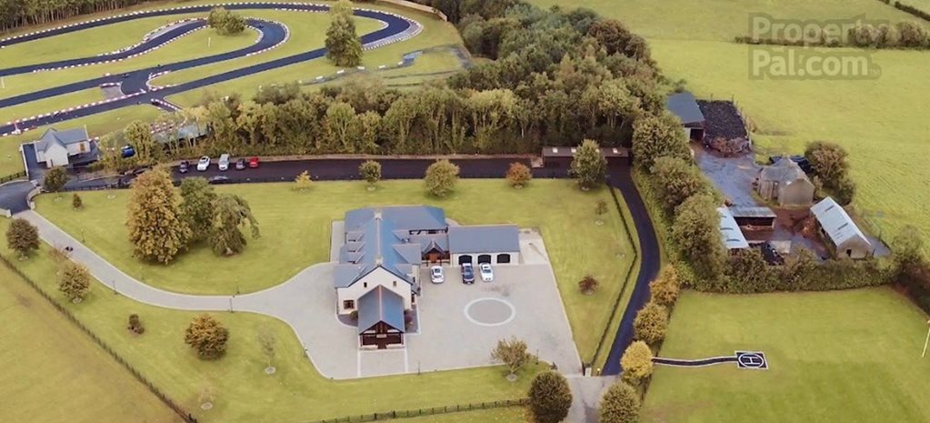 You could buy this house and kart track