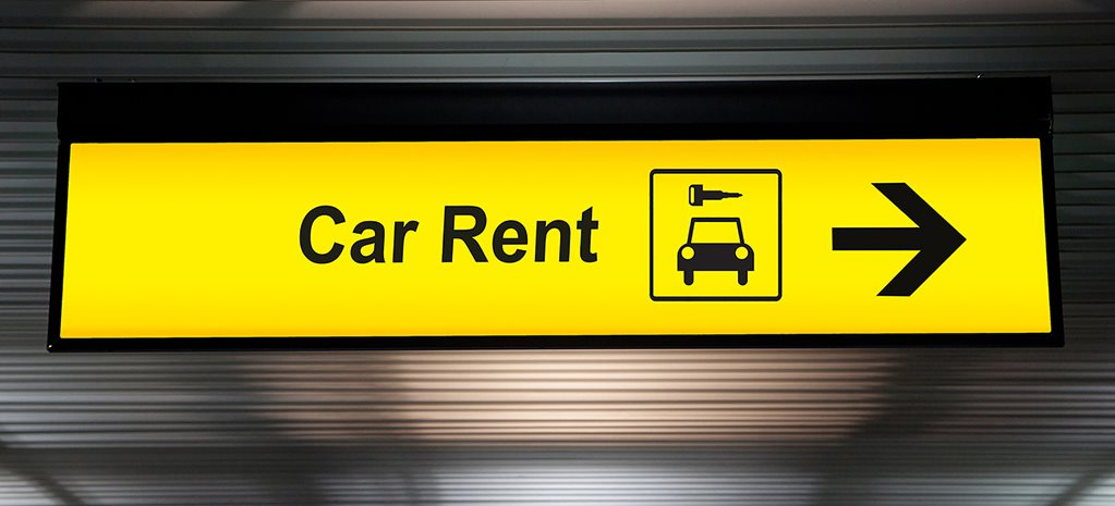 car rental airport sign