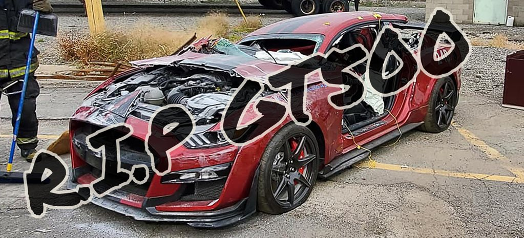 Firemen destroy a new Ford Shelby Mustang