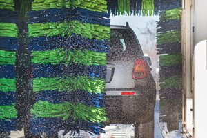 Car driving through an automatic car wash