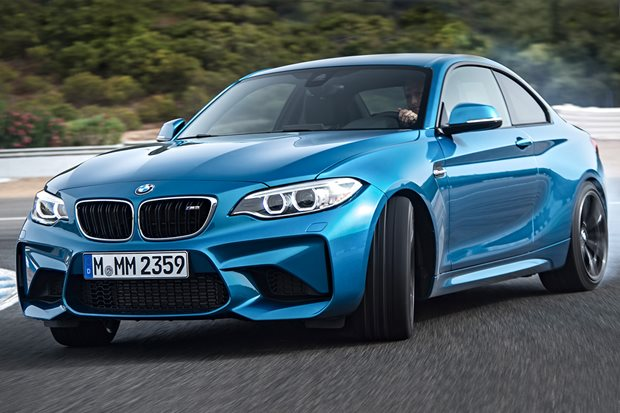 BMW M2 driving around a race track