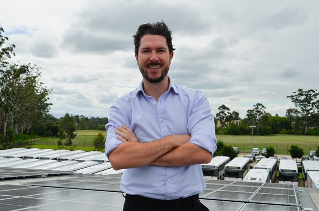 Managing Director Byron Rowe with the solar panels.jpg