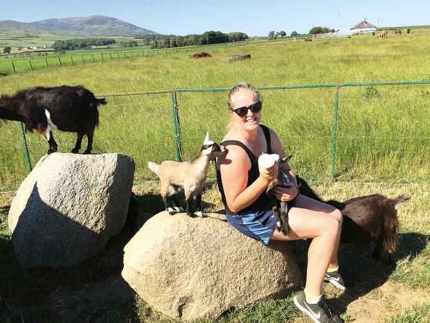 Sarah-Stark-feeds-baby-goats.jpg