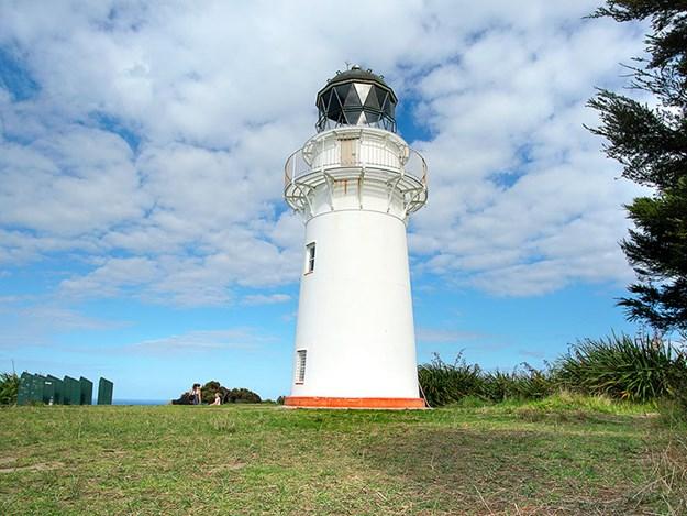 family-adventures-with-rosy-caravan-East-Cape-NZ---Harvey-_-Chelsea-at-the-Light-House.jpg