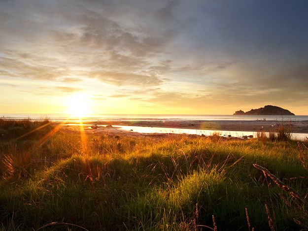 family-adventures-with-rosy-caravan-Sunrise-2---Anaura-Bay-DOC-Campground-East-Cape.jpg
