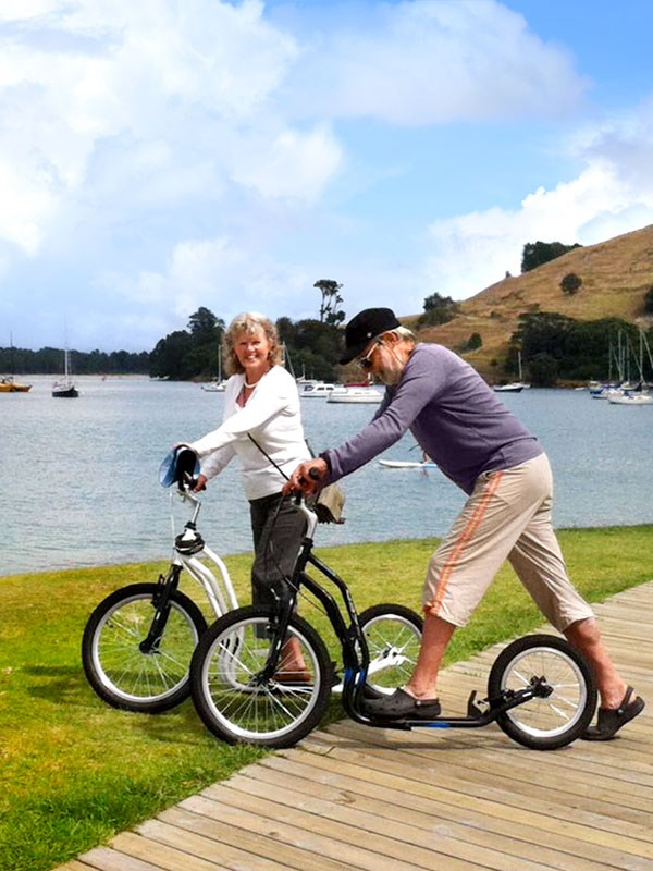 Whelan_4-On-the-scooters-at-Mt-Maunganui-buster-the-bus.jpg