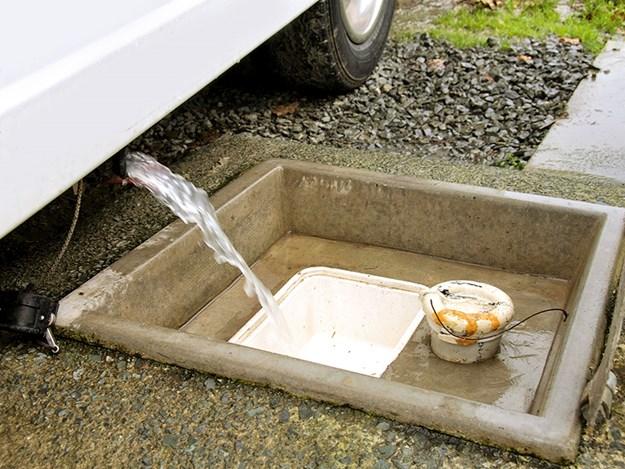 rv water tanks Grey waste water discharging directly into dump station drain copy.jpg